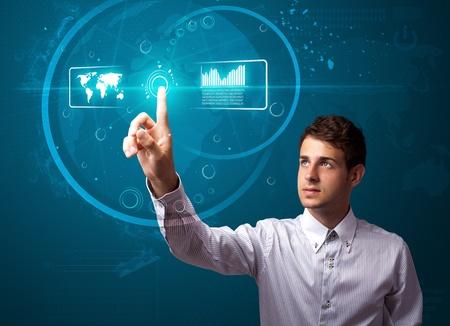 touchscreen: Hombre de negocios presionando el tipo de alta tecnolog�a de botones moderno en un fondo virtual Foto de archivo