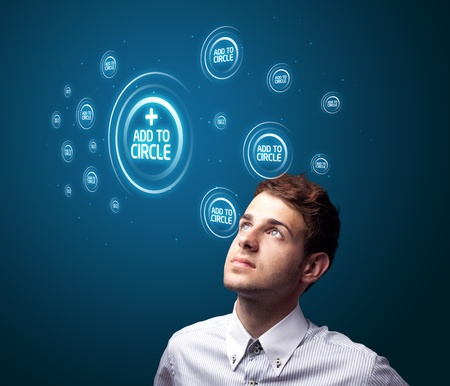 Businessman pressing modern social buttons on a virtual background Stock Photo - 10687900