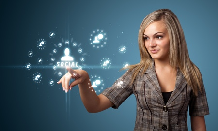 social relation: Businesswoman pressing modern social buttons on a virtual background Stock Photo