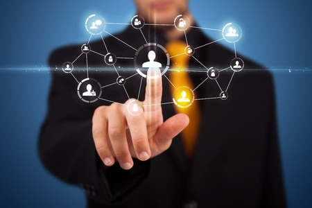 press media: Businessman pressing modern social buttons on a virtual background Stock Photo