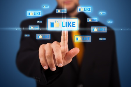 like button: Businessman pressing modern social buttons on a virtual background Stock Photo
