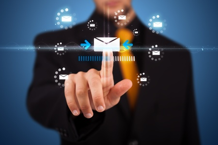 Businessman pressing messaging type of modern icons with virtual background photo
