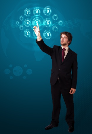 touch screen interface: Businessman pressing high tech type of modern buttons on a virtual background