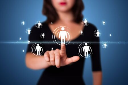 technology people: Businesswoman pressing modern social buttons on a virtual background Stock Photo