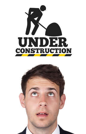 construct: Young persons head looking at construction signs Stock Photo