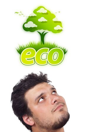 Young persons head looking at green eco sign photo
