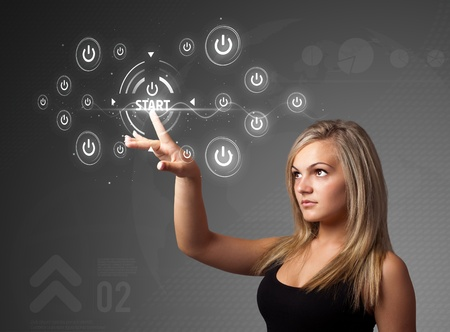 futuristic woman: Businesswoman pressing simple start buttons on a virtual background
