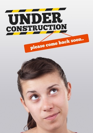 Young girl head looking at construction signs photo