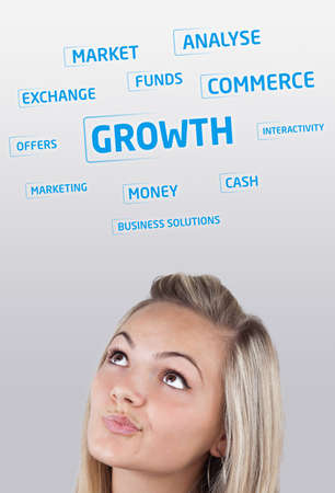 Young girl head looking at business icons and images photo