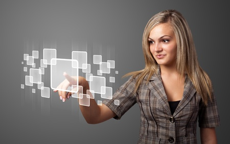touch screen interface: Businesswoman pressing high tech type of modern buttons on a virtual background