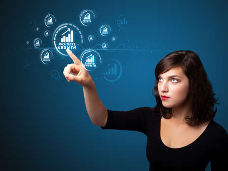 Businesswoman pressing business type of modern buttons with virtual background photo