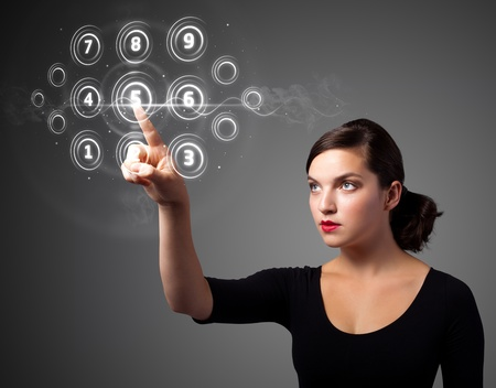 Businesswoman pressing high tech type of modern buttons on a virtual background photo