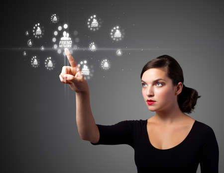 Businesswoman pressing modern social buttons on a virtual background photo