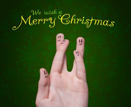Happy group of finger smileys with merry christmas sign  photo