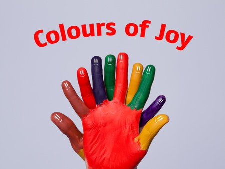 Colorful happy finger smileys with colours of joy sign on grey background photo