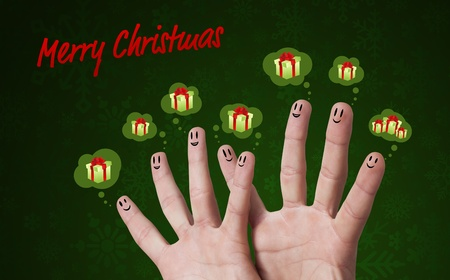 Happy group of finger smileys with merry christmas sign and presents photo