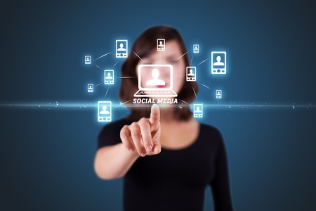 press media: Businesswoman pressing modern social buttons on a virtual background Stock Photo