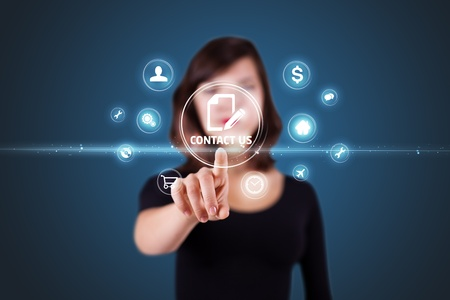 Businesswoman pressing messaging type of modern icons with virtual background photo