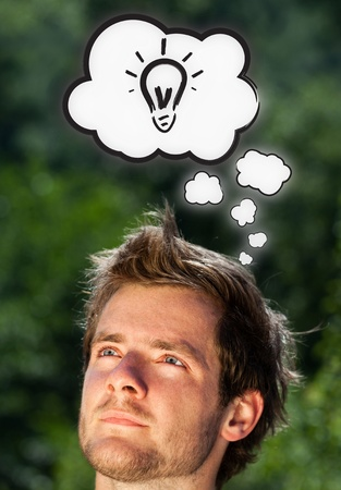 Young persons head thinking about white clouds photo