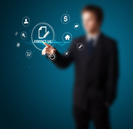 Businessman pressing messaging type of modern icons with virtual background Stock Photo - 11946555
