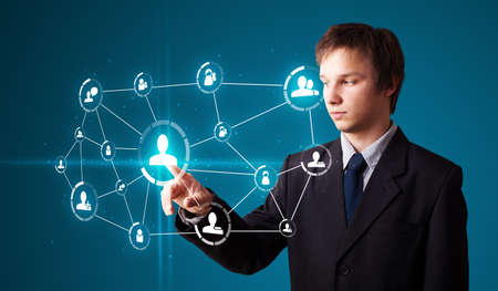 Businessman pressing modern social buttons on a virtual background Stock Photo - 11969577