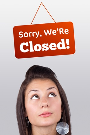 Young girl head looking at closed and open signs photo