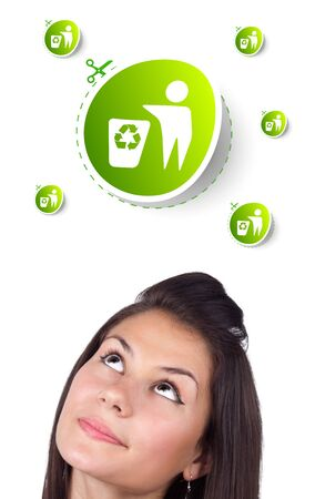 Young girl head looking at green eco sign photo