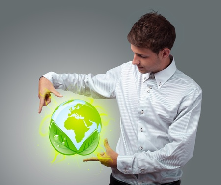 Young businessman holding virtual eco sign Stock Photo - 12025833
