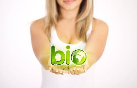 Woman hands holding ECO sign, Concept Save green planet. Symbol of environmental protection photo