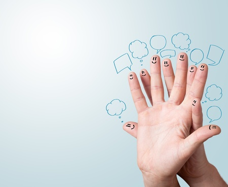 Happy finger smileys with speech bubbles. Stock Photo - 11985459