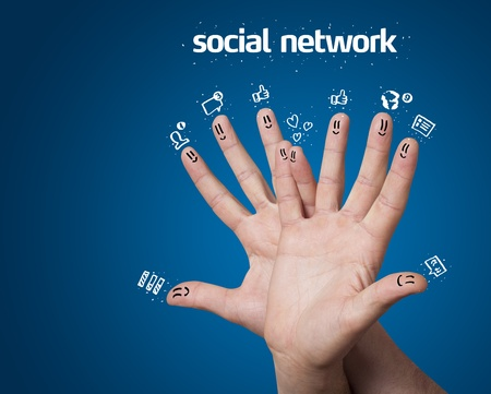 Happy group of finger smileys with social network sign and icons on blue background Stock Photo - 11985635