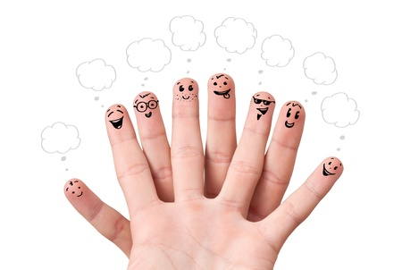 Happy finger smileys with speech bubbles. photo