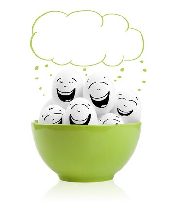 breakfast smiley face: Happy painted eggs in a bowl, isolated on white Stock Photo