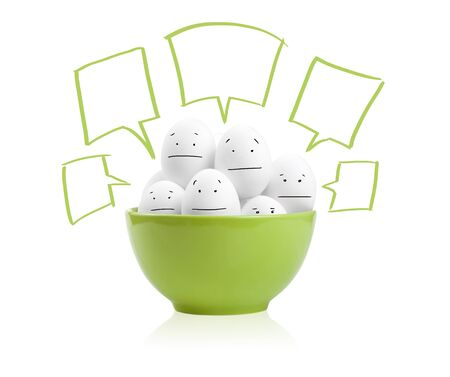 Happy painted eggs in a bowl, isolated on white photo