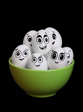 A group of funny and happy egg smiley collection in bowl photo