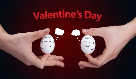 Eggs with happy smiley faces on valentines day theme Stock Photo - 11985407
