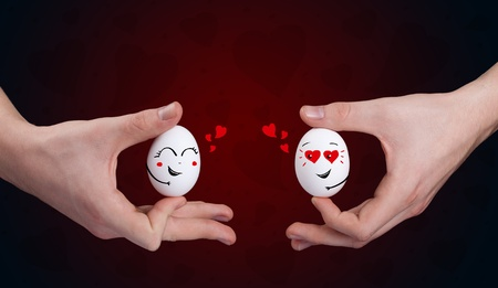 Eggs with happy smiley faces on valentines day theme Stock Photo - 11985400