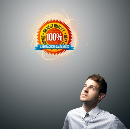 Young businessman watching virtual business sign, copyspace Stock Photo