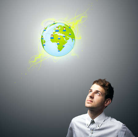 Young businessman holding virtual eco sign photo