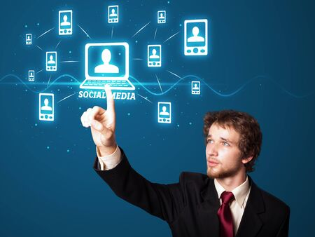 Businessman pressing modern social buttons on a virtual background Stock Photo - 12089239