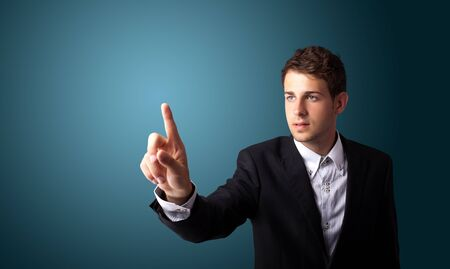 Businessman pressing an imaginary button on bokeh  photo