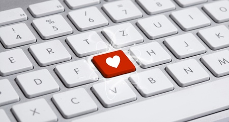 computer key: White keyboard with heart sign Stock Photo