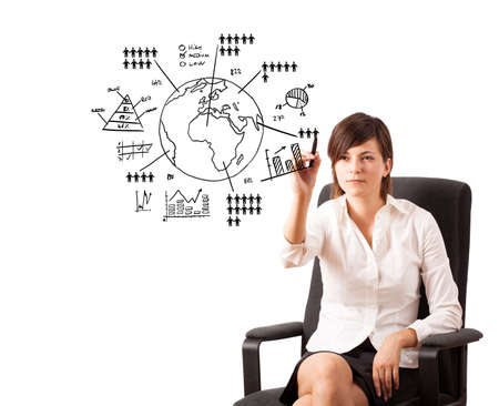 Young woman drawing globe with various diagrams isolated on white Stock Photo - 16283816