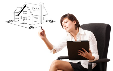 Young woman drawing a house on whiteboard isolated on white Stock Photo - 16283701