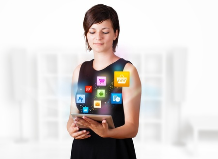 woman tablet: Young business woman looking at modern tablet with colourful icons