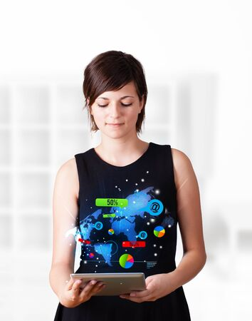 Young business woman looking at modern tablet with colourful technology icons photo
