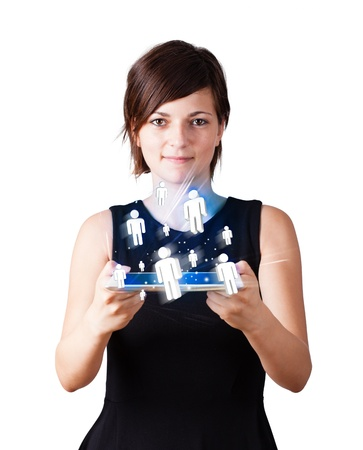 Young business woman looking at modern tablet with social icons photo