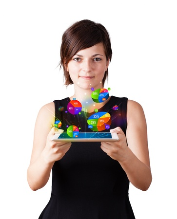 Young business woman looking at modern tablet with colourful pie charts Stock Photo - 16245202