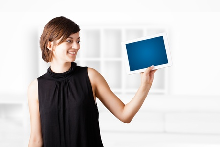 Young business woman looking at modern tablet Stock Photo - 16290356