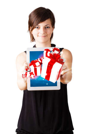 Young business woman looking at modern tablet with present boxes photo